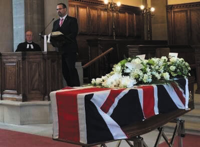Mr Bush delivers the eulogy at  the funeral of Mr. Russell