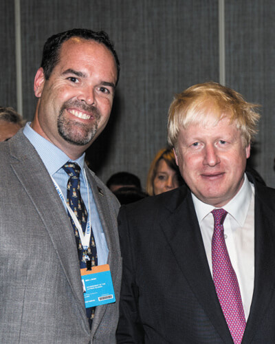 Mr. Bush with Mr. Boris Johnson